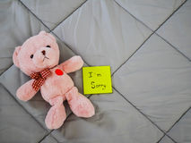Post it with teddy doll Stock Image