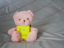 Post it with teddy doll Royalty Free Stock Photography