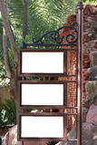 Post with three blank posters to write a text or put photos. Nice wrought iron display of vintage style with three blank posters to write a text or put photos Royalty Free Stock Photo