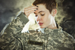 Post traumatic stress. A female US Army soldier with post traumatic stress Stock Photography