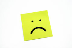 Post it with unhappy face Stock Photography