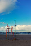 Post volleyball court and a high chair at the beach in autumn Royalty Free Stock Photo