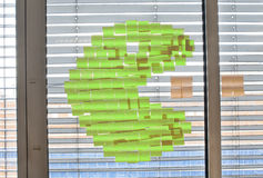 Post it wars. Pac-man in a post-it war Royalty Free Stock Photography