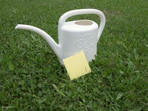 Post-it and watering Royalty Free Stock Photography