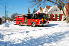 Post winter storm street in Valley Stream, LI. Fire truck on the street in Valley Stream after the snow storm in Jan 2014 Royalty Free Stock Images