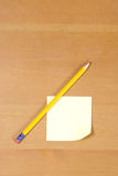 A post it on a wood desk Stock Photo