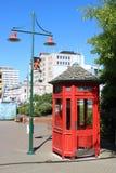 Posta della lampada, cabina telefonica rossa, Christchurch, NZ immagini stock