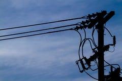 Posta elettrica della siluetta Fotografie Stock
