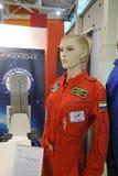 Postać kobieta w astronautycznych kostiumach Zdjęcia Stock