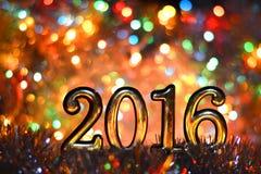 Postacie 2016 w jaskrawych światłach (nowy rok, boże narodzenia,) Zdjęcie Stock
