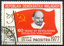 Postage stam devoted 60 years October revolution. REPUBLICA DEMOCRATICA MALAGASY - CIRCA 1977: A stamp printed in Malagasy (Madagaskar) shows Lenin, devoted 60 Royalty Free Stock Photos