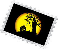 Postage stamp - 14. Halloween's night. Pumpkin and dead tree on moon background for your Halloween Royalty Free Stock Photo