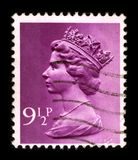 Postage stamp. UNITED KINGDOM - CIRCA 1990: An English Used First Class Postage Stamp printed in UNITED KINGDOM showing Portrait of Queen Elizabeth in pink vector illustration