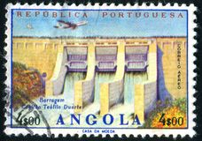 Postage stamp. ANGOLA - CIRCA 1965: stamp printed by Angola, shows Teofilo Duarte Dam, circa 1965 royalty free stock images