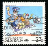 Postage stamp. AUSTRALIA - CIRCA 1988: stamp printed by Australia, shows Cartoons, Postal services circa 1988 Royalty Free Stock Photo
