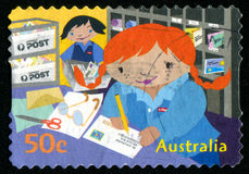 Postage stamp. AUSTRALIA - CIRCA 2006: stamp printed by Australia, shows Kate Writing address on letter, circa 2006 Stock Photo