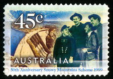 Postage stamp. AUSTRALIA - CIRCA 1999: stamp printed by Australia, shows worker and dam, circa 1999 stock photo