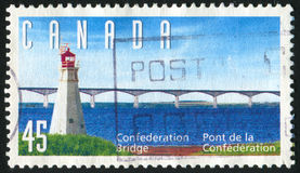 Postage stamp. CANADA - CIRCA 1997: stamp printed by Canada, shows lighthouse and bridge, circa 1997 royalty free stock photos