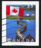Postage stamp. CANADA - CIRCA 2005: stamp printed by Canada, shows Flag And Bridge Bouctuoche, New Brunswick, circa 2005 royalty free stock photos