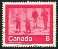Postage stamp. CANADA - CIRCA 1974: stamp printed by Canada, shows skier, circa 1974 royalty free stock photography