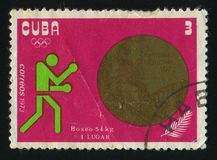 Postage stamp. CUBA - CIRCA 1972: A  stamp printed by Cuba,  shows medals Won by Cubans at the 1972 Summer Olympics, Munich, circa 1972 Royalty Free Stock Photo