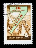 Postage stamp devoted to meat production and shows plesant woman with two pigs, cows and poultry, circa 1958. MOSCOW, RUSSIA - JUNE 26, 2017: A stamp printed in Stock Photography
