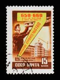 Postage stamp devoted to Oil refinery, shows man by the machine, circa 1958 Royalty Free Stock Photos