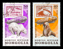 The Postage Stamp. DZERZHINSK, RUSSIA - FEBRUARY 11, 2016: Set of a postage stamp of MONGOLIA shows Graf Zeppelin, circa 1981 Stock Images