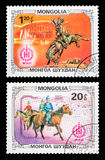 Postage stamp. DZERZHINSK, RUSSIA - FEBRUARY 11, 2016: Set of a postage stamp of MONGOLIA shows Horsemen, circa 1981 Royalty Free Stock Images