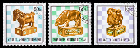 The Postage Stamp. DZERZHINSK, RUSSIA - FEBRUARY 11, 2016: Set of a postage stamp of MONGOLIA shows Japanese netsuke, chess piece, circa 1981 Stock Photos