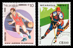 Postage stamp. DZERZHINSK, RUSSIA - FEBRUARY 04, 2016: Set of a postage stamp of NICARAGUA shows Basketball, Ice hockey, Summer Games Seoul, circa 1988 Stock Photo