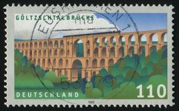 Postage stamp. GERMANY- CIRCA 1999: stamp printed by Germany, shows Goltzsch Valley Bridge, circa 1999 royalty free stock photography