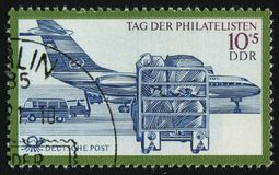 Postage stamp. GERMANY- CIRCA 1971: stamp printed by Germany, shows Loading & unloading mail at airport, circa 1971 royalty free stock photo