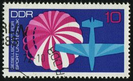 Postage stamp. GERMANY- CIRCA 1972: stamp printed by Germany, shows Parachute and light plane, circa 1972 stock photo