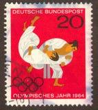 Postage stamp. GERMANY -CIRCA 1964: Struggle of two sportsmen, circa 1964 Stock Photos