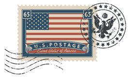 Postage stamp with the image of the American flag. Postage stamp with inscriptions and image of the American flag. Vector illustration of USA stamp with a vector illustration