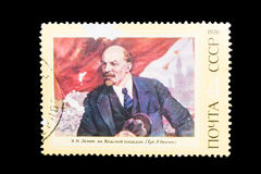 Postage Stamp isolated. TERNOPIL, UKRAINE - OCTOBER 19, 2016: A stamp printed in the USSR shows a painting by the artist Peter Vasilev Vladimir Lenin in Red Stock Image