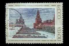 Postage Stamp isolated. TERNOPIL, UKRAINE - OCTOBER 19, 2016: a stamp printed by USSR shows a picture Parade, Red Square, 1941, by K. F Yuon  circa 1975 USSR Stock Image