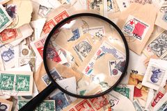 Postage stamp and magnify glass Stock Photo