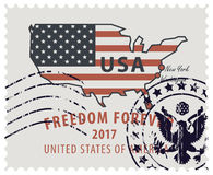 Postage stamp with map of USA in colors of flag Royalty Free Stock Photography