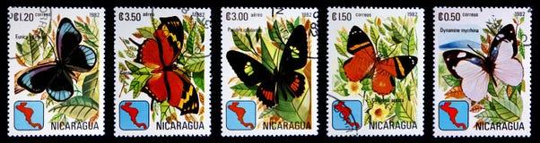 Postage stamp. NICARAGUA - CIRCA 1982: A Stamps printed in NICARAGUA shows image of butterflies: Eunica alcmena, Consul hippona, Parides iphidamas, Callizona royalty free stock photos