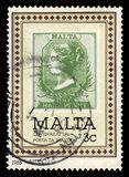 Postage stamp 12 penny 1885, centenary of Malta Post Office. Malta - CIRCA 1985: A stamp printed in Malta shows postage stamp 1/2 penny 1885, centenary of Malta royalty free stock photos