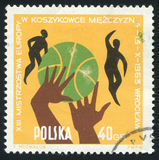 Postage stamp. POLAND - CIRCA 1963: Various positions of ball, hands and players. Town Hall, Peoples Hall and Arms of Wroclaw, circa 1963 royalty free stock photos