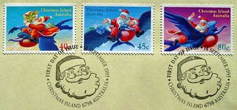Postage stamp printed in Christmas Island with of a picture Santa Claus on a bird delivers Christmas gifts. New year and Christmas royalty free stock photo