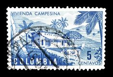 Postage stamp  printed by Colombia. Cancelled postage stamp printed by Colombia, that shows Colombian farm, circa 1950 stock image