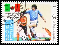 Free Postage Stamp Printed In Laos Shows Play Scenes, World Cup Football Serie, 3 Lao Kip, Circa 1985 Stock Photo - 167248780