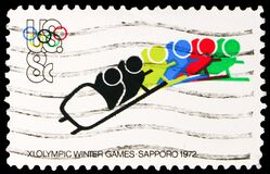 Free Postage Stamp Printed In United States Shows Bobsledding And Olympic Rings, Olympic Games 1972 - Munich And Sapporo Serie, 8 C - Royalty Free Stock Photography - 170924057