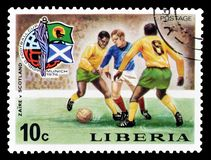 Postage stamp printed by Liberia. Cancelled postage stamp printed by Liberia, that shows football match Zaire versus Scotland, circa 1974 stock photos