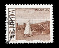 Postage stamp printed by Poland. Cancelled postage stamp printed by Poland, that shows bridge in Warsaw, circa 1966 royalty free stock photo