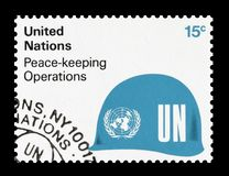 Postage stamp printed by United Nations. That Promotes Peace keeping operations, circa 1980 royalty free stock image